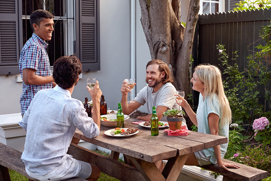 man toasting speech at friends outdoor garden party with wine dr