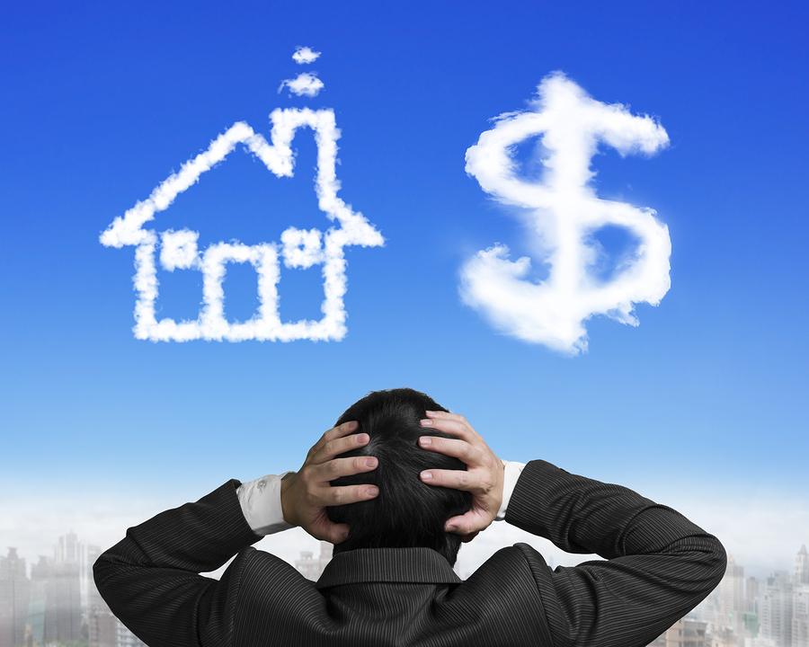 Dollar Sign House Shape Clouds With Businessman Hand Holding Hea